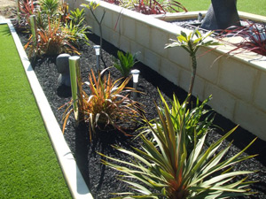 All Seasons Synthetic Turf - Mulch, no more re-mulching needed!